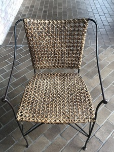 Wicker weave and black metal designer chair front s300